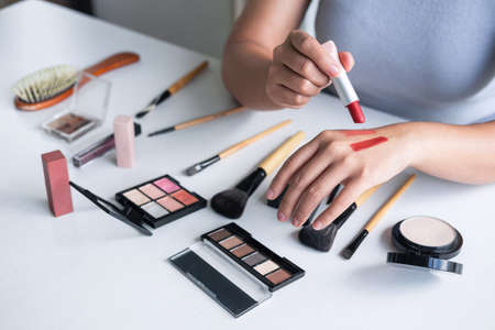 Elegant female Beauty blogger showing testing beauty cosmetic using product makeup tutorial cosmetics and sale product.
