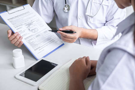 Doctor consulting with patient and checking sickness condition while presenting results diagnosis symptom examining about the problem of illness and recommend treatment method, Healthcare and medical. 写真素材