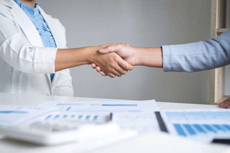 Finishing up a conversation after collaboration, handshake of two business woman leader after successful contract agreement to become a partner, collaborative negotiation partnership. Stockfoto