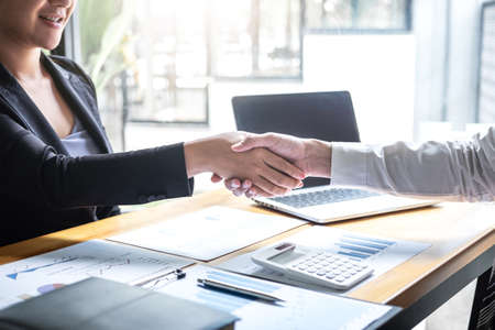 Finishing up a conversation after collaboration, handshake of two business people after contract agreement to become a partner, collaborative teamwork.