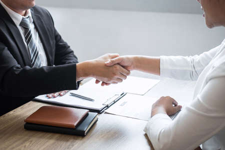 Successful job interview, Image of Boss employer committee or recruiter in suit and new employee shaking hands after good deal negotiation interviewing, career and placement concept.