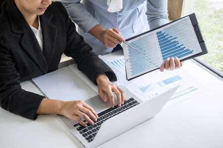 Businesswoman leader team conference on meeting presentation to planning investment project working and strategy of business making conversation with partner, financial and accounting concept. Stock Photo