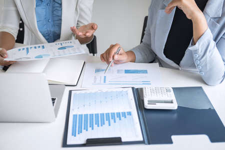 Executive business woman team brainstorming on meeting to conference planning investment project working and strategy of business making conversation with partner, financial and accounting concept. Stock Photo - 131733513