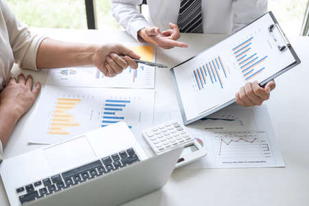 Group of Business leader team conference on meeting presentation to planning investment project working and strategy of business making conversation with partner, financial and accounting concept. Stock Photo - 131733493