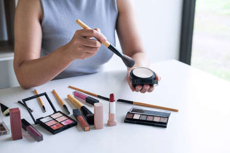 Elegant female Beauty blogger showing testing beauty cosmetic using product makeup tutorial cosmetics and sale product. Stock Photo - 132753755
