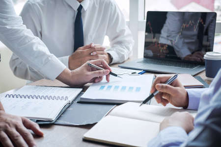 Business team discussion on meeting to planning investment trading project and strategy to investor of deal on a stock exchange with partner, financial and accounting concept, collaborative teamwork. Stock Photo - 131727102