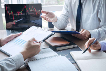 Business team discussion on meeting to planning investment trading project and strategy to investor of deal on a stock exchange with partner, financial and accounting concept, collaborative teamwork. Stock Photo - 131727650