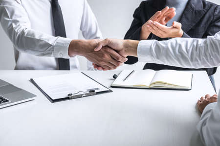 Successful job interview, Image of Boss employer committee or recruiter in suit and new employee shaking hands and clap after good deal negotiation interviewing, career and placement concept.