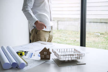 Construction engineering or architect working on blueprint inspection in workplace, while checking information drawing and sketching for architecture project working. Stock Photo - 131728256