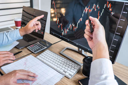 Business team on meeting to planning investment trading project and strategy of deal on a stock exchange with partner, financial and accounting concept, collaborative teamwork analyze data.
