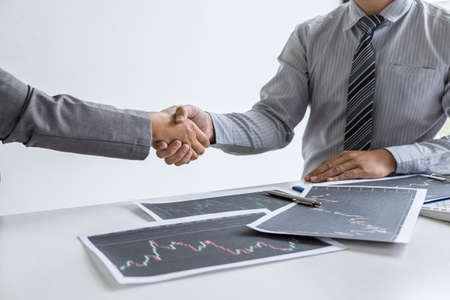 Finishing up a conversation after collaboration, handshake of two business woman leader after successful contract agreement to become a partner, collaborative negotiation partnership. Stok Fotoğraf