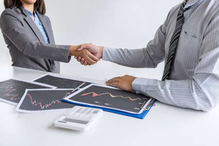 Finishing up a conversation after collaboration, handshake of two business woman leader after successful contract agreement to become a partner, collaborative negotiation partnership. Фото со стока