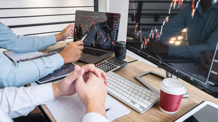Business team on meeting to planning investment trading project and strategy of deal on a stock exchange with partner, financial and accounting concept, collaborative teamwork analyze data. Фото со стока - 138085176