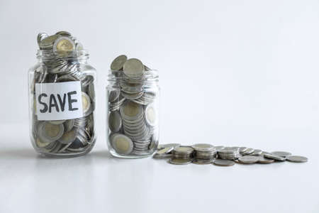 Images of coin in piggy bank for step up growing business to profit and saving with piggy bank, Saving money for future plan education and retirement fund concept.