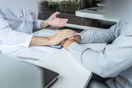 Image of doctor holding patients hand to encourage, talking with patient cheering and support, healthcare and medical assistant.