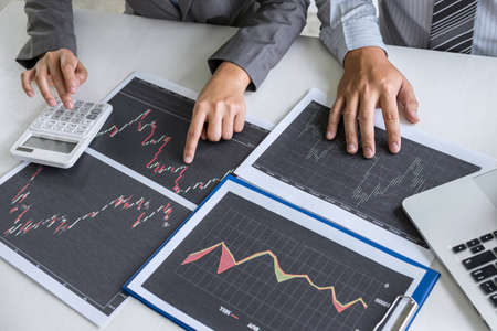 Business team discussion on meeting to planning investment trading project and strategy to investor of deal on a stock exchange with partner, financial and accounting concept, collaborative teamwork. Stock Photo