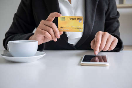 Young woman consumer holding smartphone, credit card and typing for online shopping and payment make a purchase on the Internet, Online payment, networking and buy product technology.