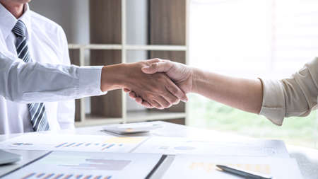 Finishing up a conversation after collaboration, handshake of two business people after success good deal contract negotiation agreement to become a partner, collaborative teamwork.