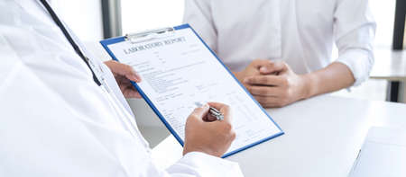 Doctor having conversation with patient while discussing explaining symptoms or counsel diagnosis health and consult treatment of disease, healthcare and assistance concept.