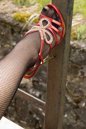 Sexy legs in red stiletto high heels