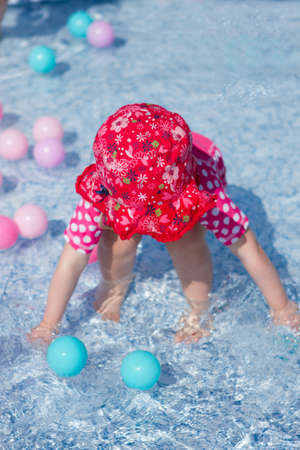 Child paddling in a pool
