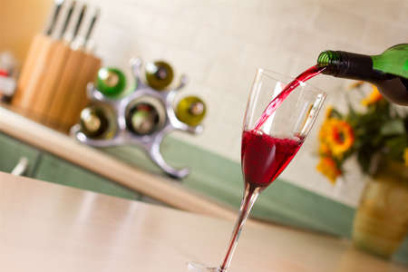 Wine being poured into a glass Stock Photo - 14935374