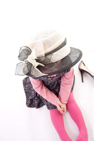 Little girl playing dress up Stock Photo