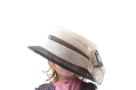 Little girl wearing a large hat Stock Photo