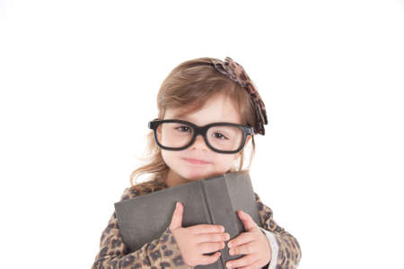 Child reading a book wearing large glasses