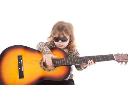 prodigio: Bambina in possesso di una chitarra Archivio Fotografico