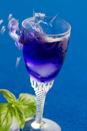 Blue cocktail drink isolated against blue Stock Photo