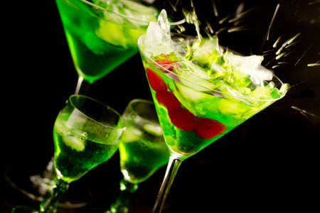 Party drinks isolated against black photo