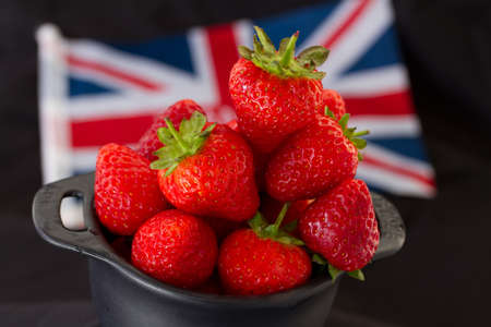 Strawberries isolated against the british flag