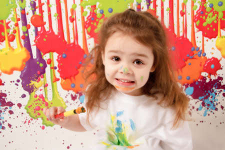 Child covered in paint photo