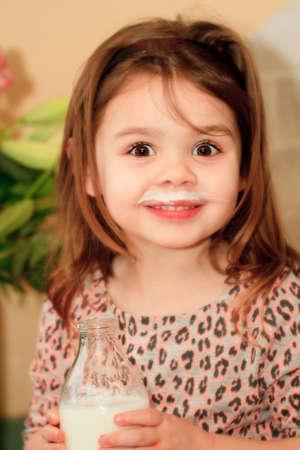 Child drinking milk photo