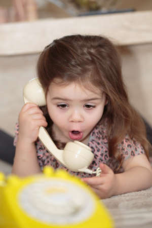 Child talking on a telephone