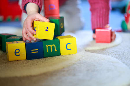 Little hands playing with building blocks Stock Photo