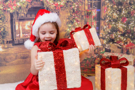 Christmas, happy child holding Christmas presents