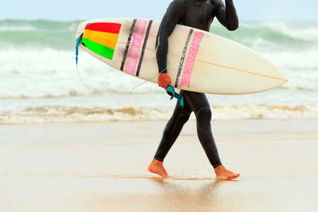 Surfer hold a surfboard photo