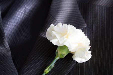 buttonhole: White flower on a suit jacket buttonhole