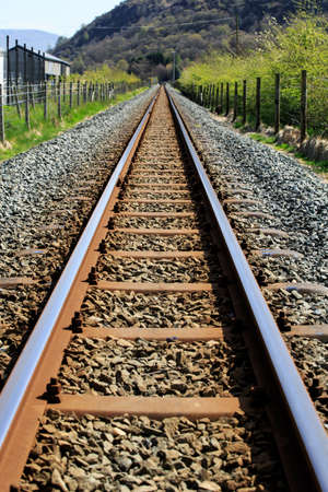Railway track leading to a mountain