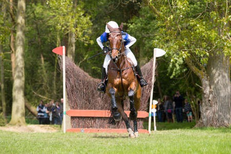 Horse and Rider at a show jumping event Stock Photo