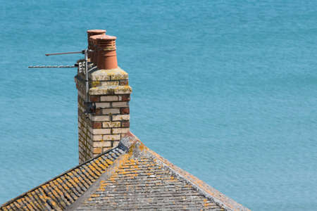 man made structure: Chimney Pots on a roof top