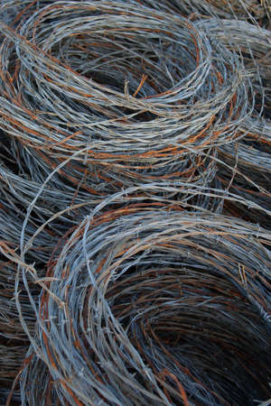 Hand-rolled coils of old wire. photo