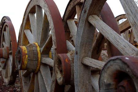 old wood farm wagon: Old wooden wagon wheels. Stock Photo