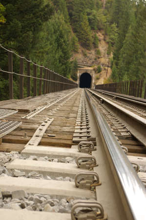 View of railroad trestle and tunnel from the rail. Stock Photo