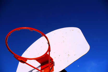 Outdoor basketball hoop at a playground without a net. photo