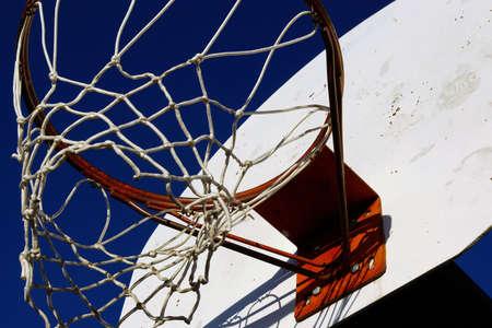 backboard: Outdoor basketball hoop with a backboard and a net. Stock Photo