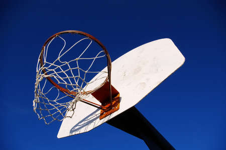 Basketball hoop on an outdoor court at a playground. Stock Photo