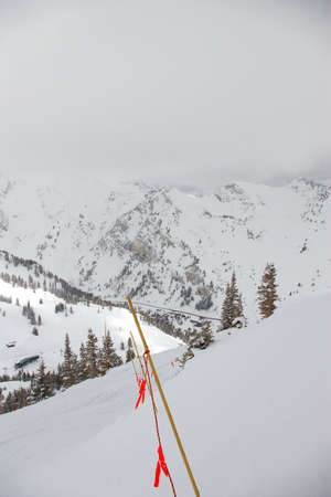 flagging: Safety rope line in a steep area of a ski resort. Stock Photo
